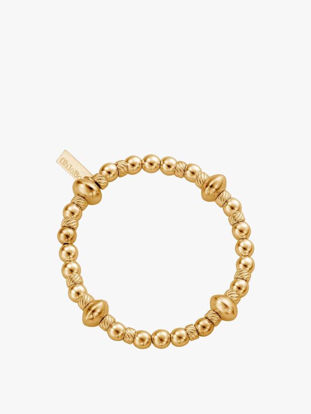 Gold Twisted Disc Filler Bracelet